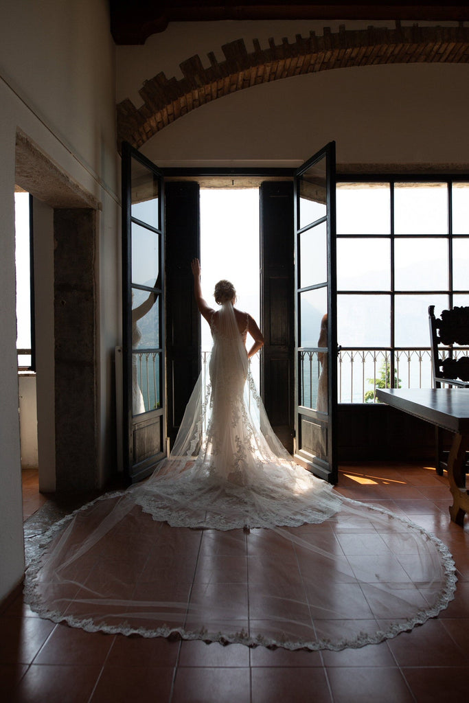 royal length lace wedding veil and lace gown