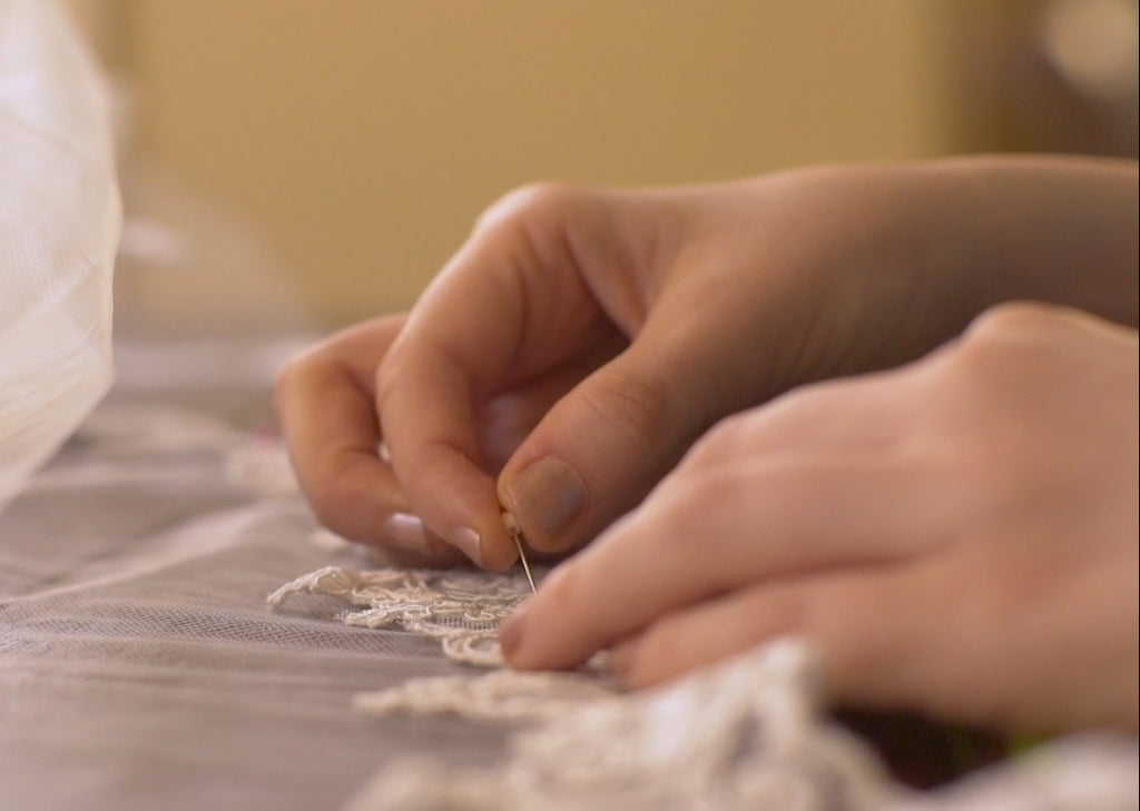 sewing and pinning your wedding veil