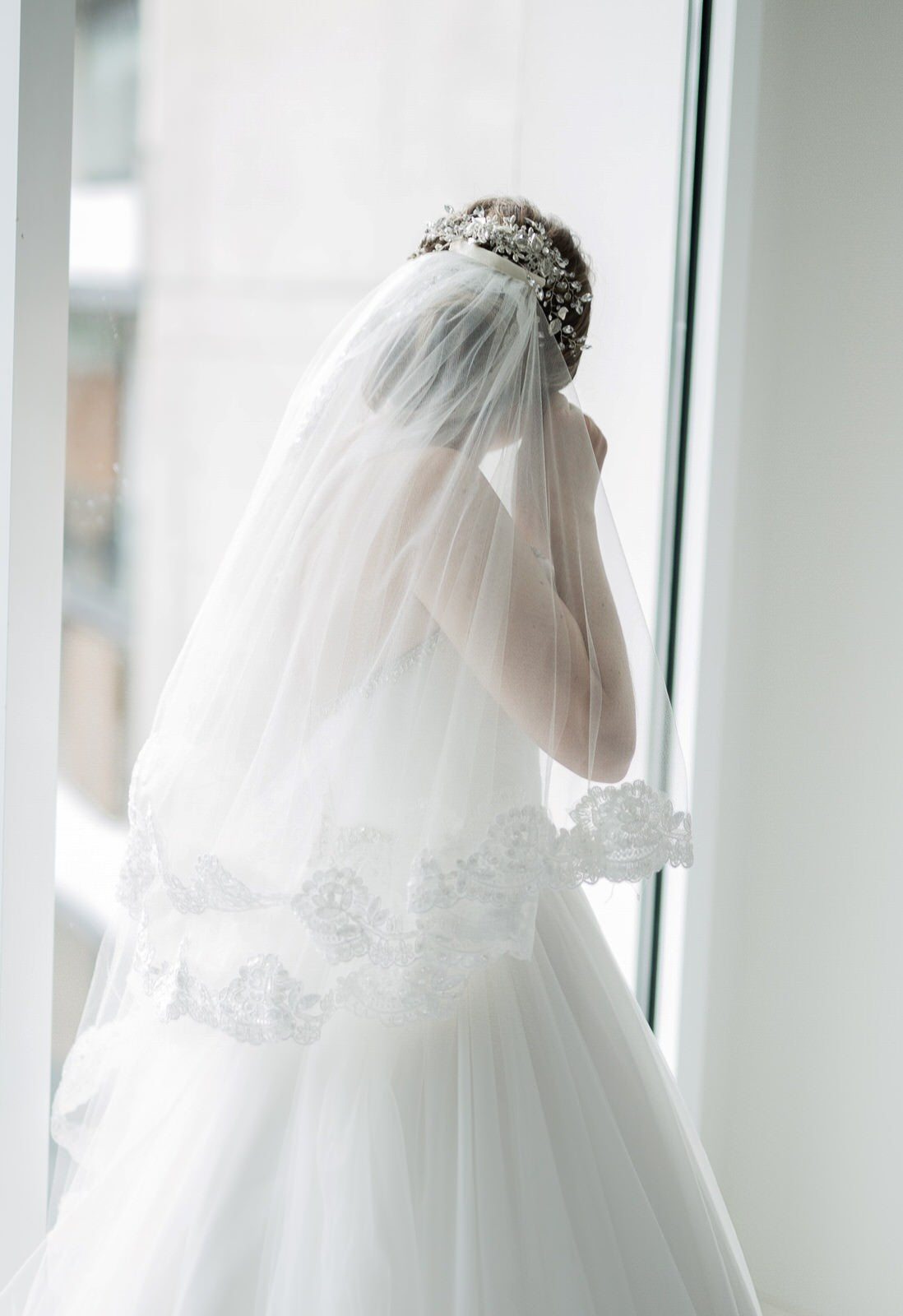 two layer wedding veil with lace over updo with flower beaded hairpiece