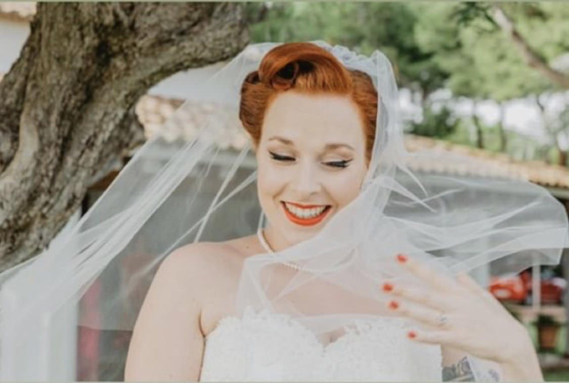 1950s bride with updo and simple single layer veil