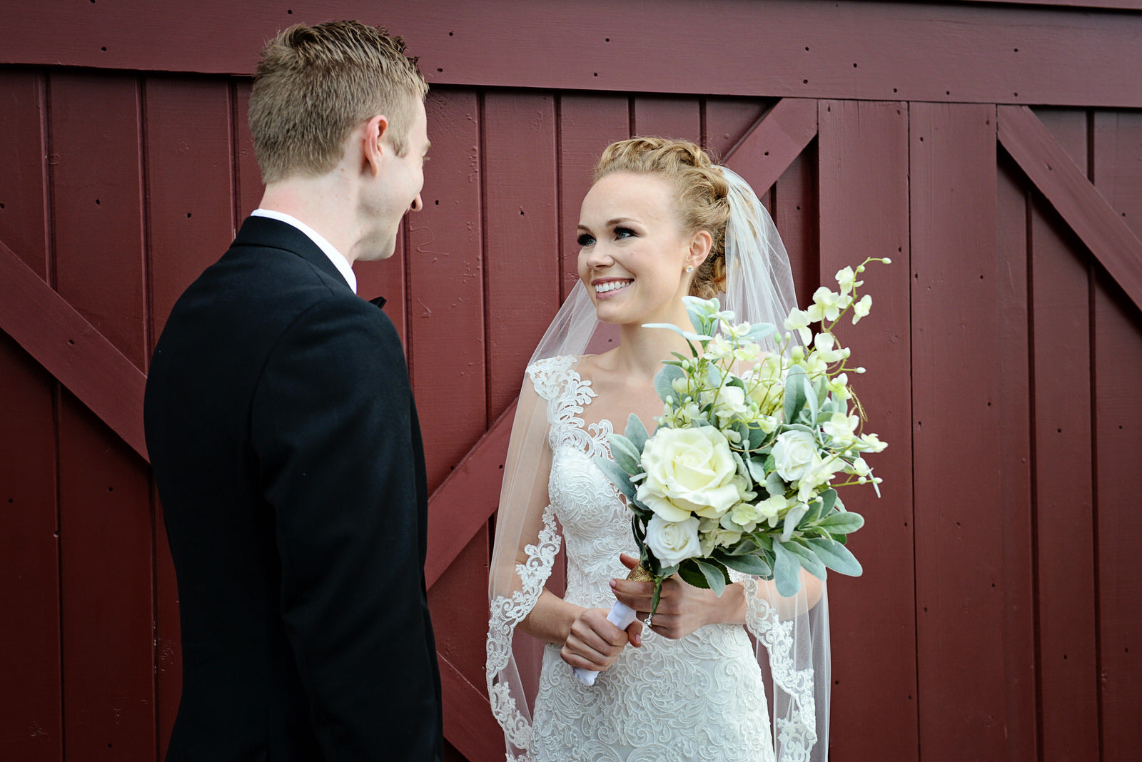 barn wedding with bride wearing lace fingertip wedding veil