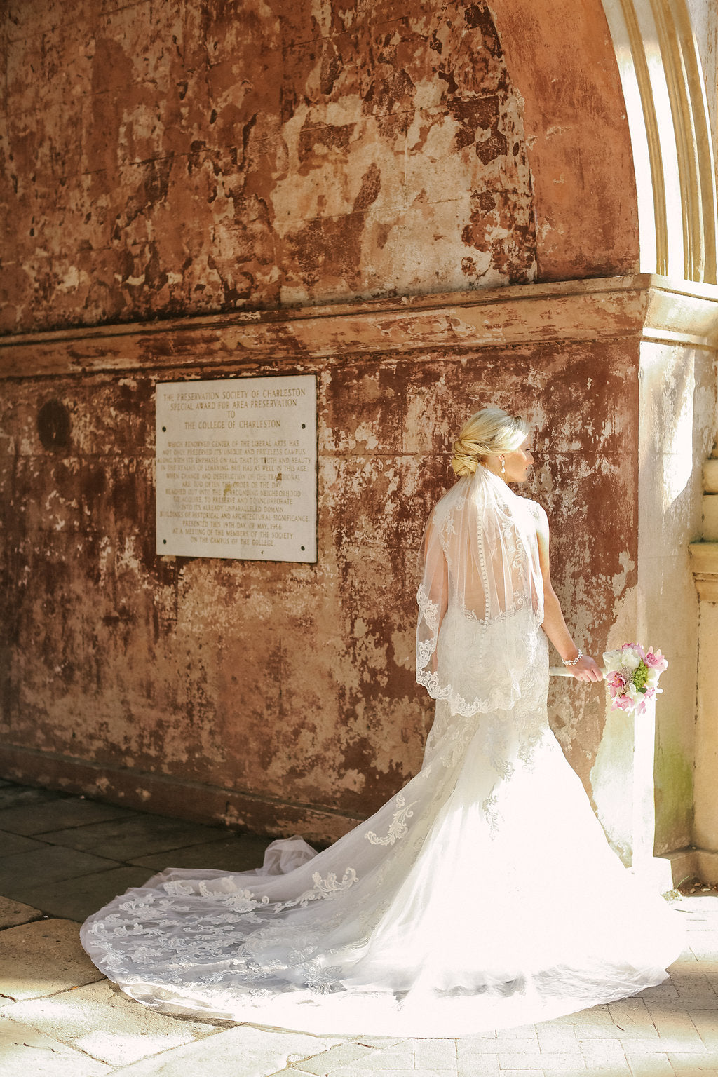 Bridal Portrait of Dress with Long Train and Short Elbow Length Wedding Veil