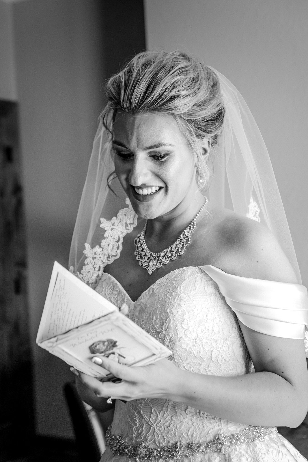 classic bride reading note wearing flower lace elbow length veil