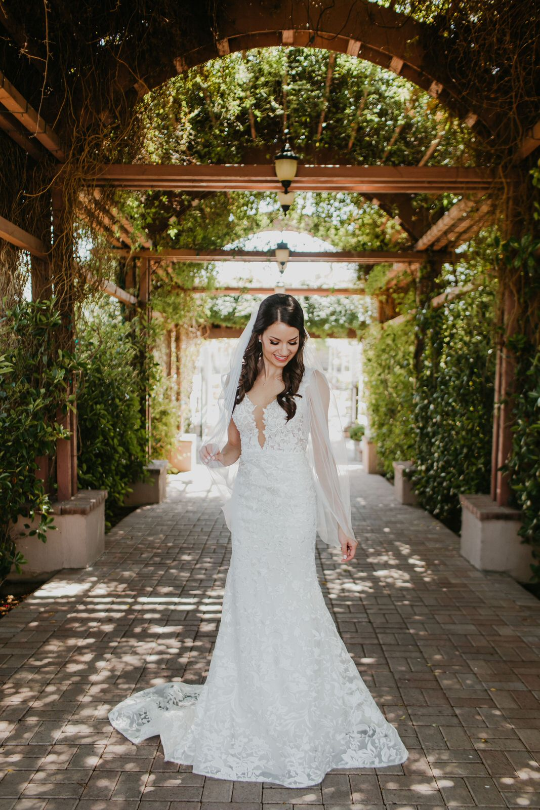 vineyard wedding with sheer one tier fingertip length veil