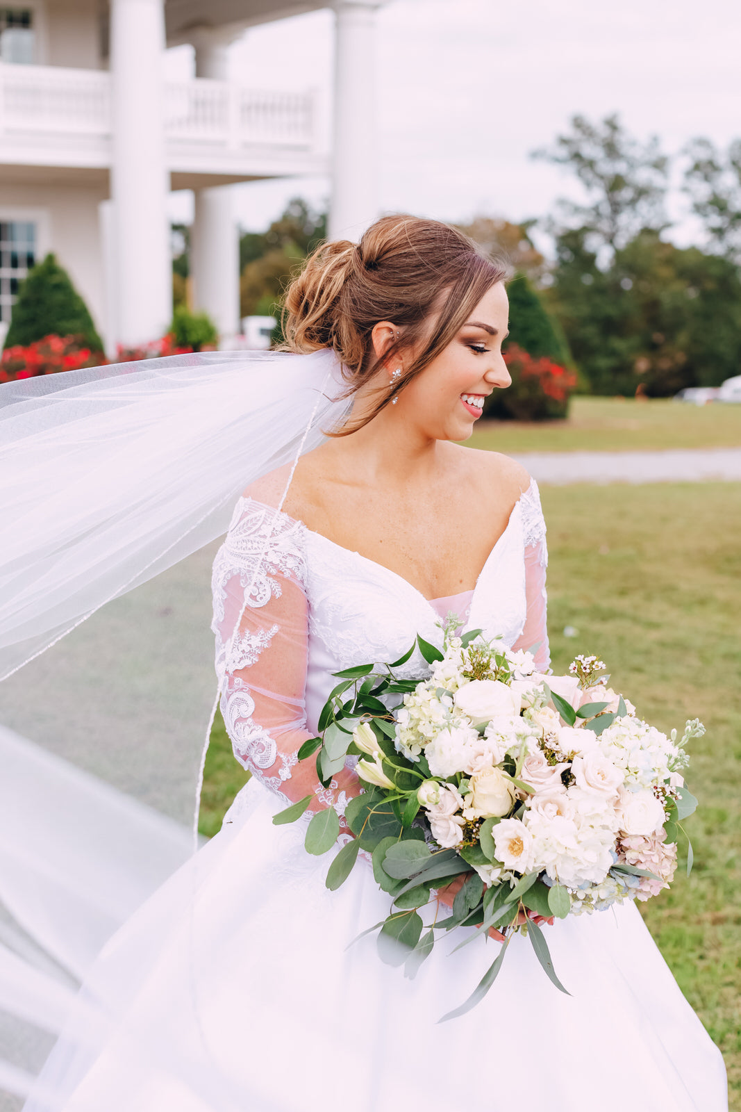 beaded edged wedding veil underneath elegant updo