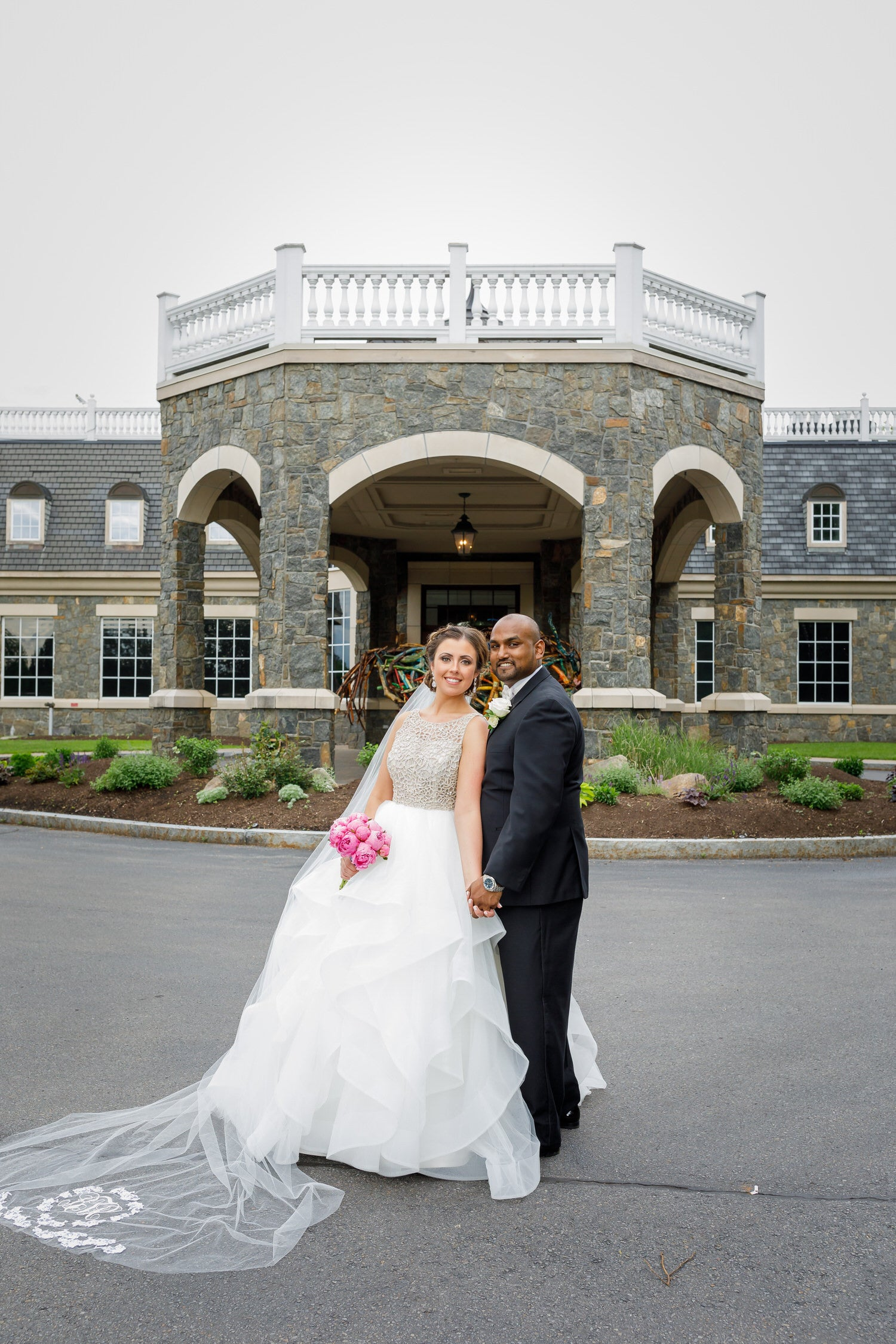 formal castle wedding with bride in ballgown and long monogrammed veil