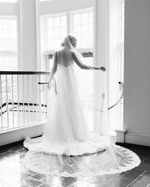 strapless silk gown with long cathedral lace edged veil