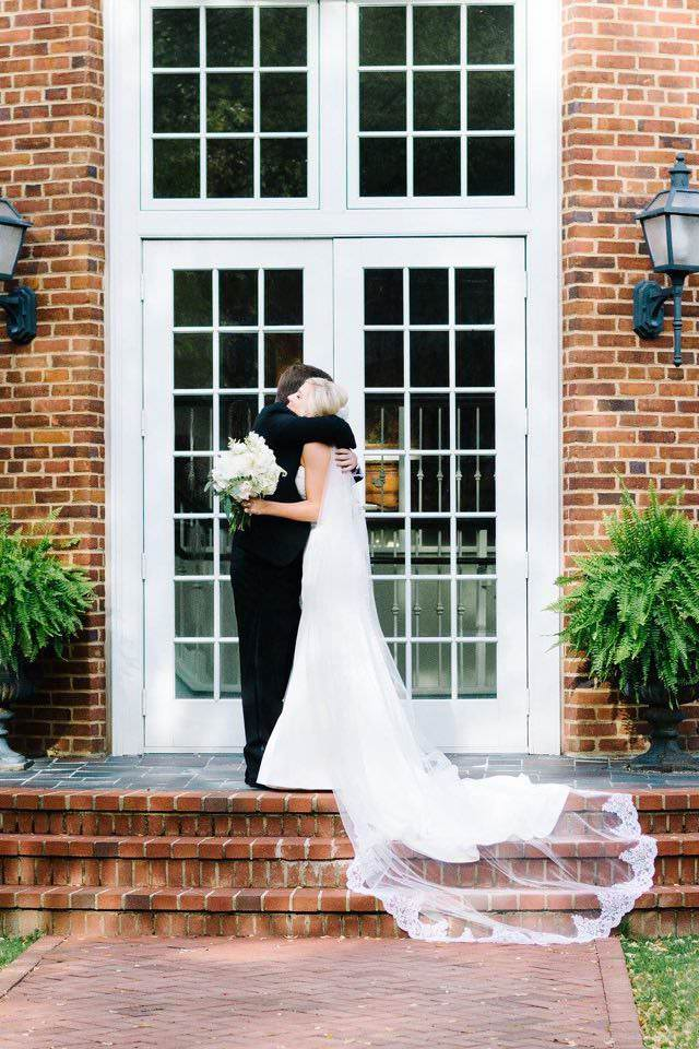 mansion wedding with bride in long lace edged cathedral veil