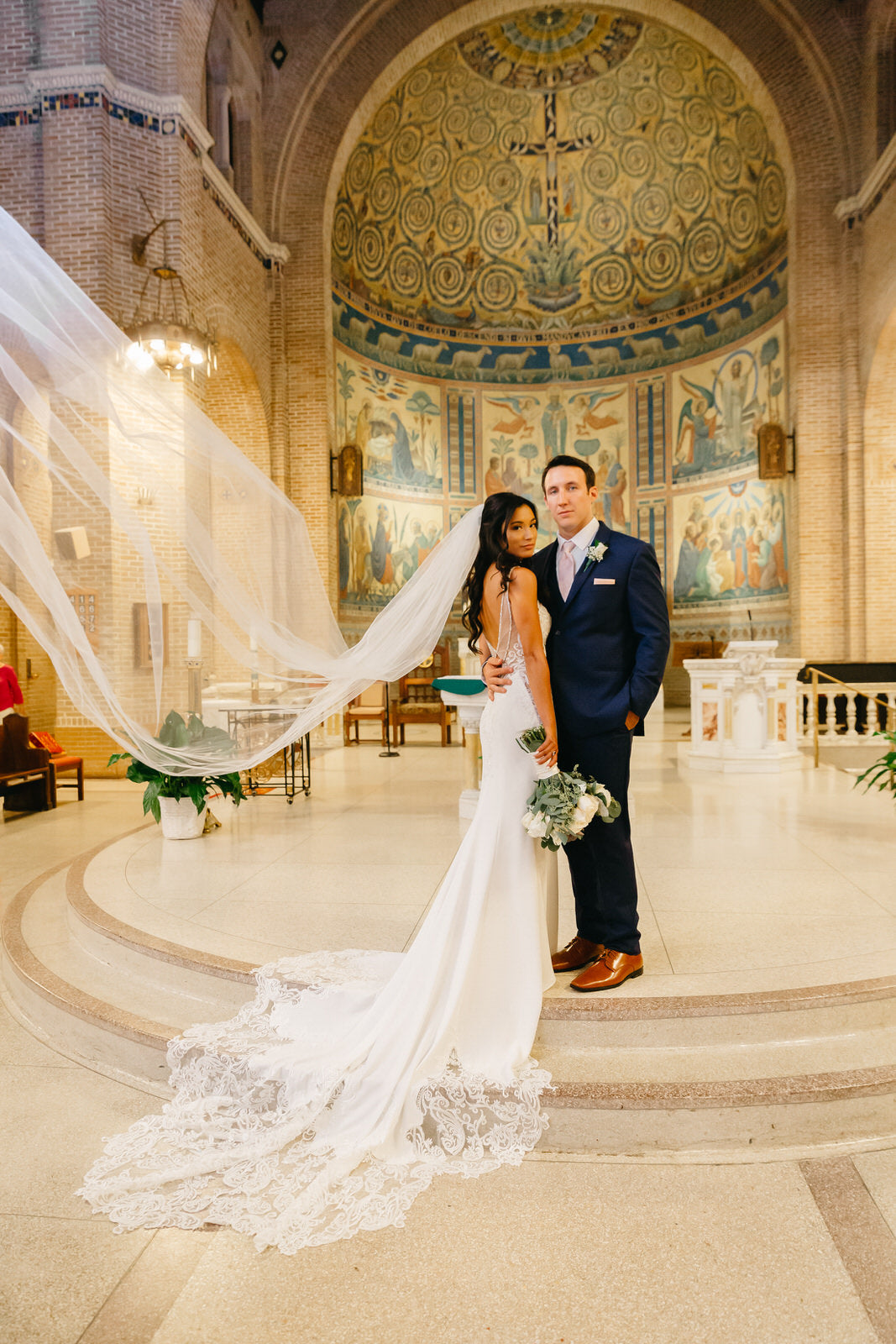 formal catholic wedding with bride in long cathedral length beaded bridal veil