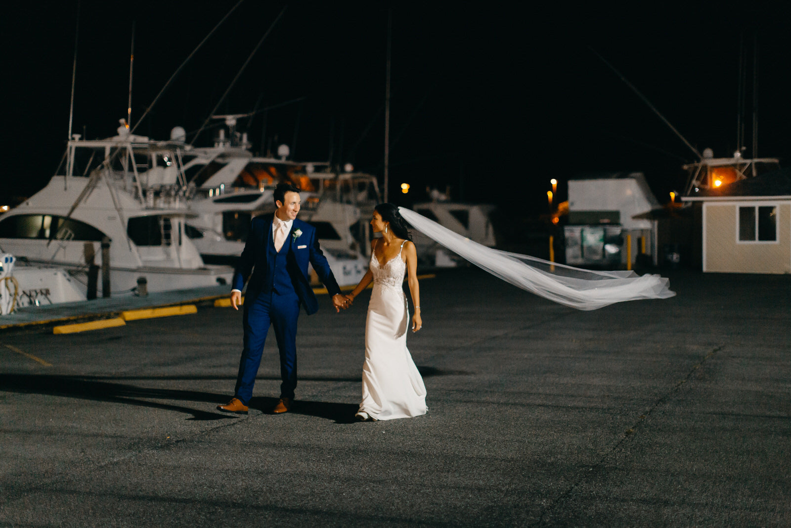 pier wedding with bride wearing long chapel length wedding veil with scattered crystals