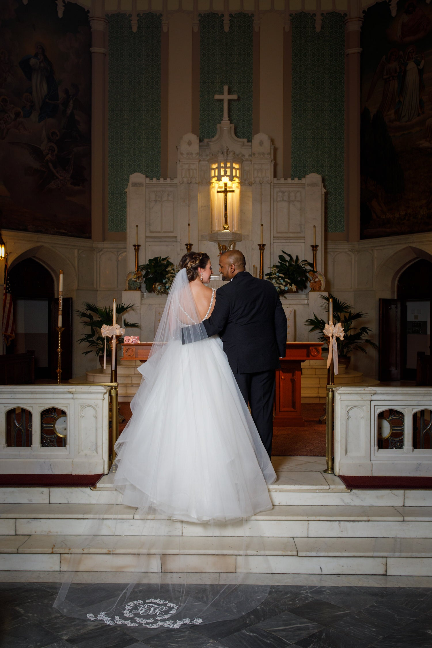 catholic church traditional wedding with cathedral veil with monogram