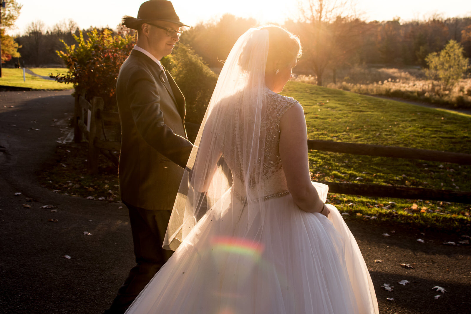 rustic farm wedding with bride wearing scattered rhinestone fingertip veil