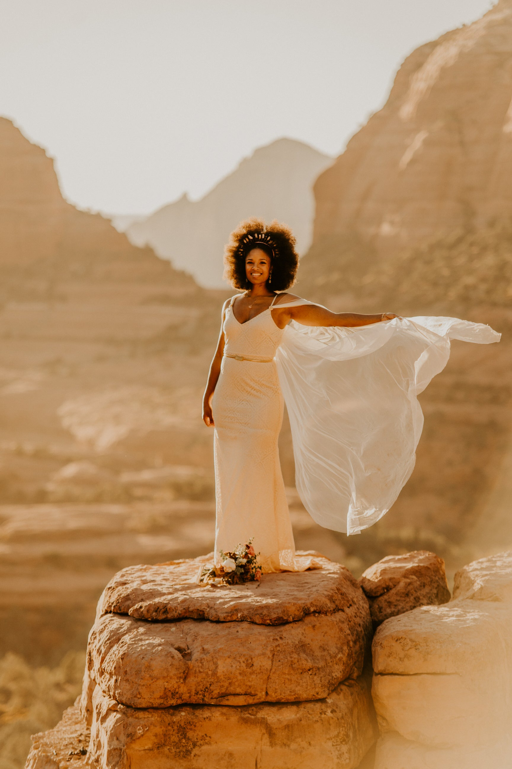 desert outdoor wedding with soft ivory long cape