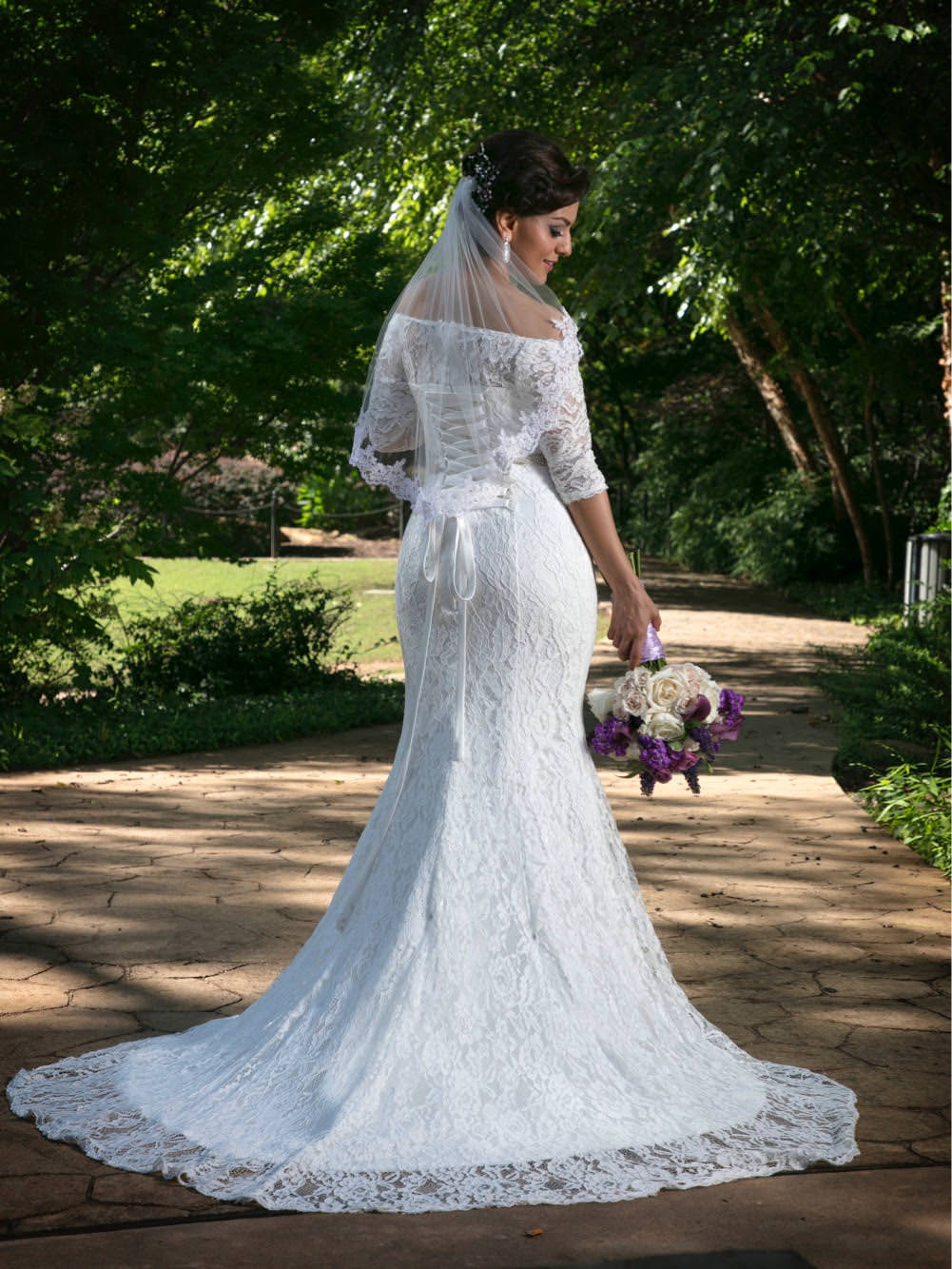 elegant bride in short lace edged wedding veil in ivory