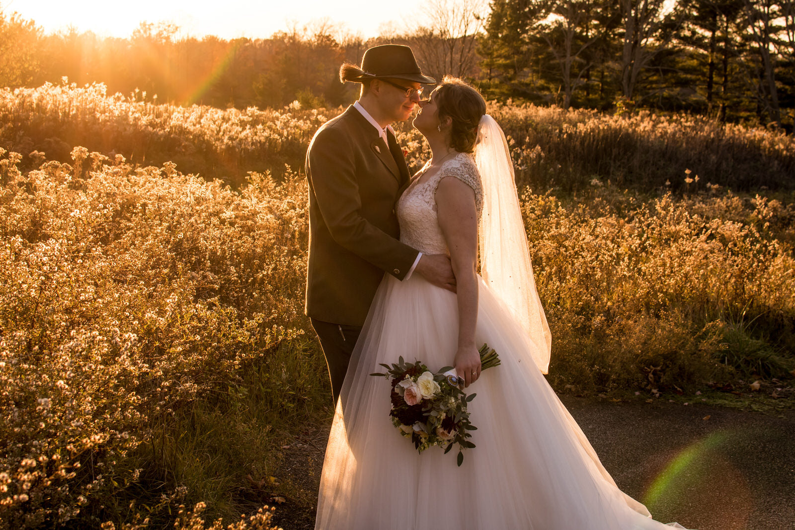 farm wedding with bride in mid length beaded wedding veil