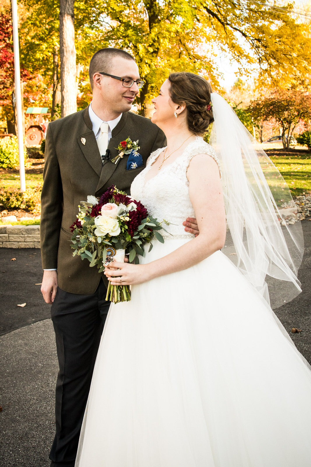 fall wedding with bride wearing crystal wedding veil over updo