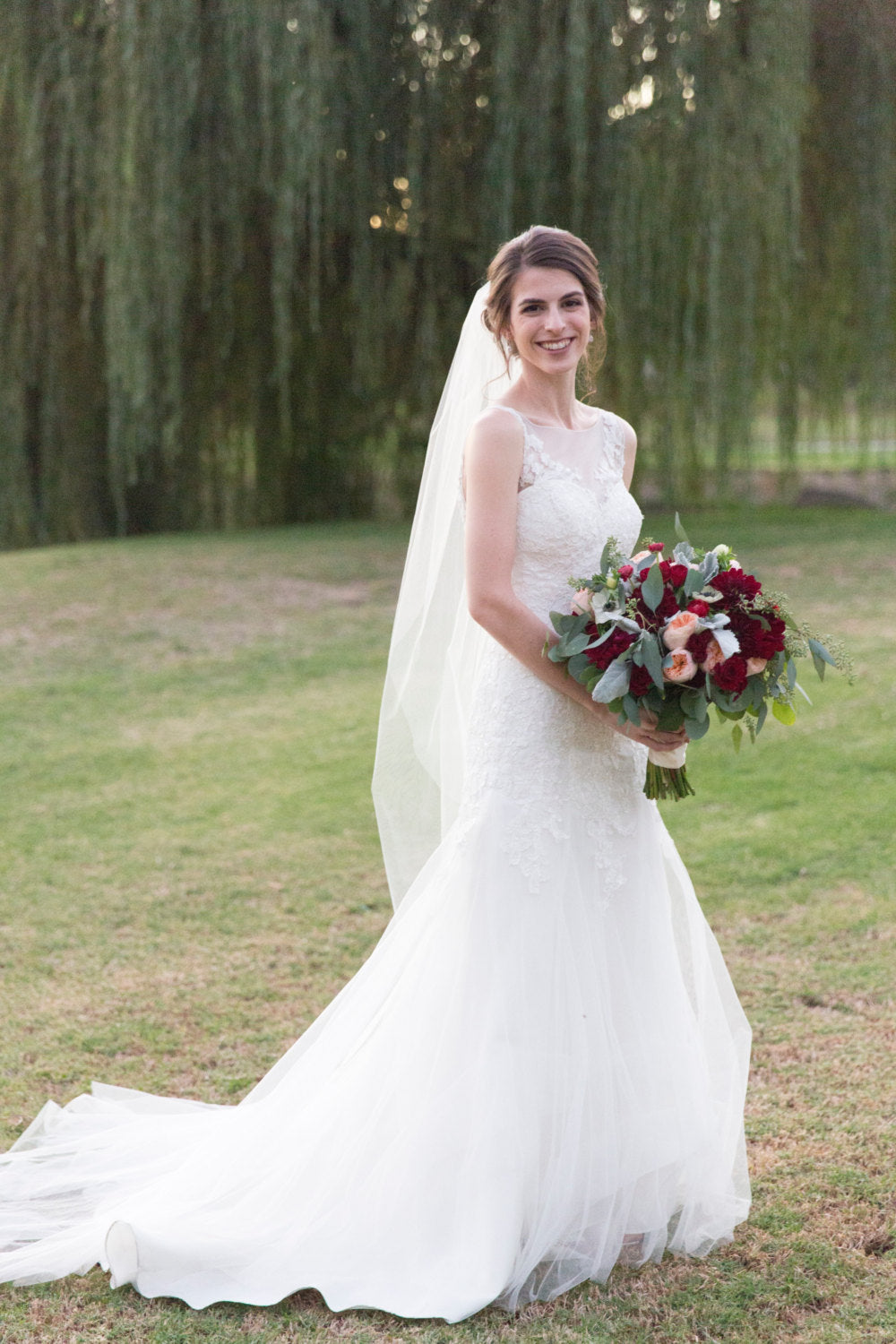 waltz length veil and lace wedding dress