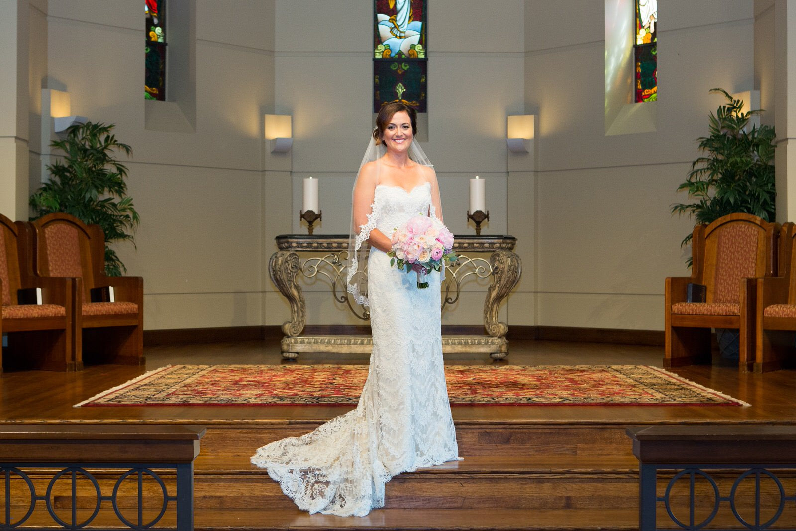 church wedding with bride in lace fingertip length wedding veil