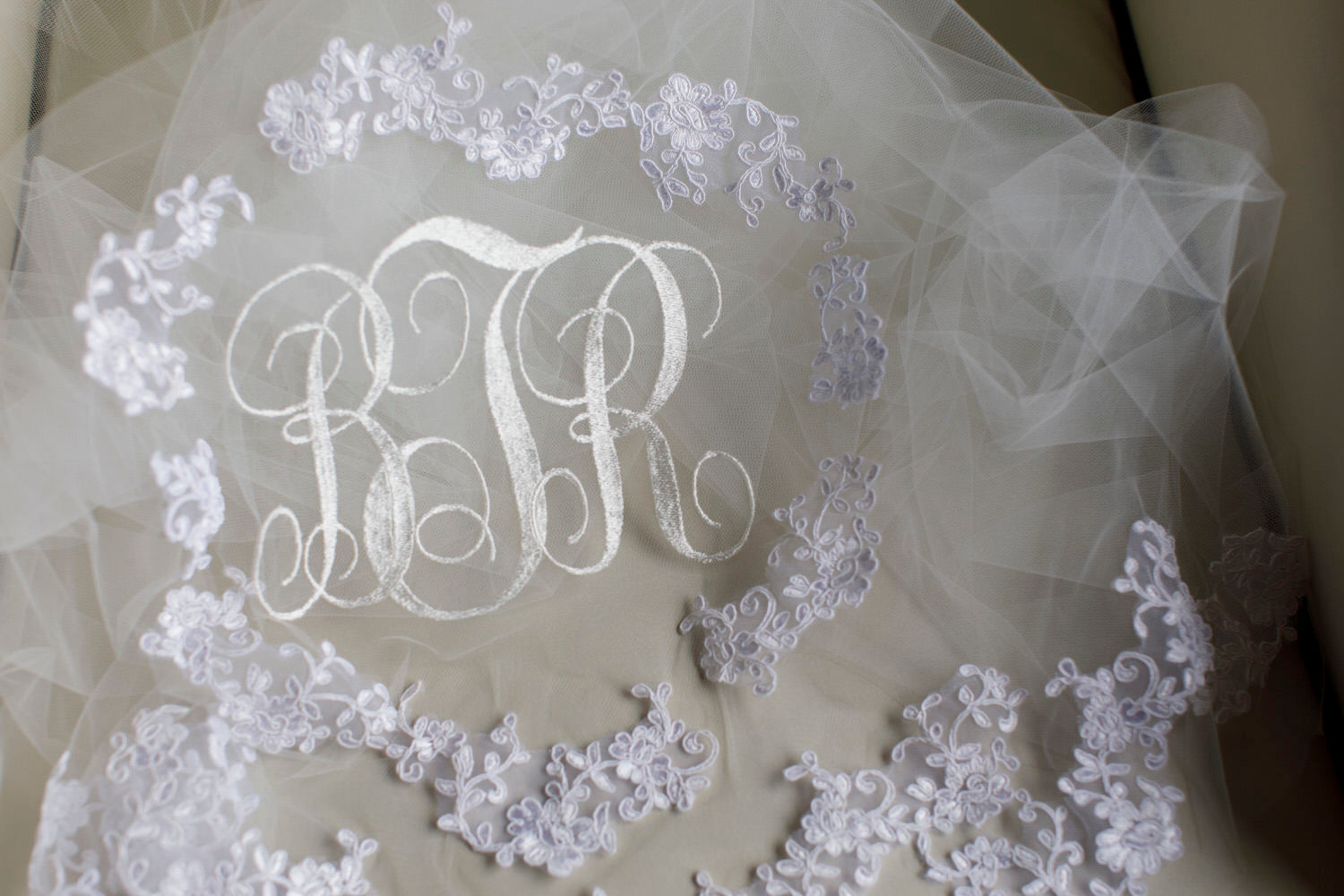 lace applique and monogrammed embroidered veil in off white
