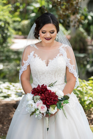 burgundy wedding with bride in sweetheart dress and short lace veil
