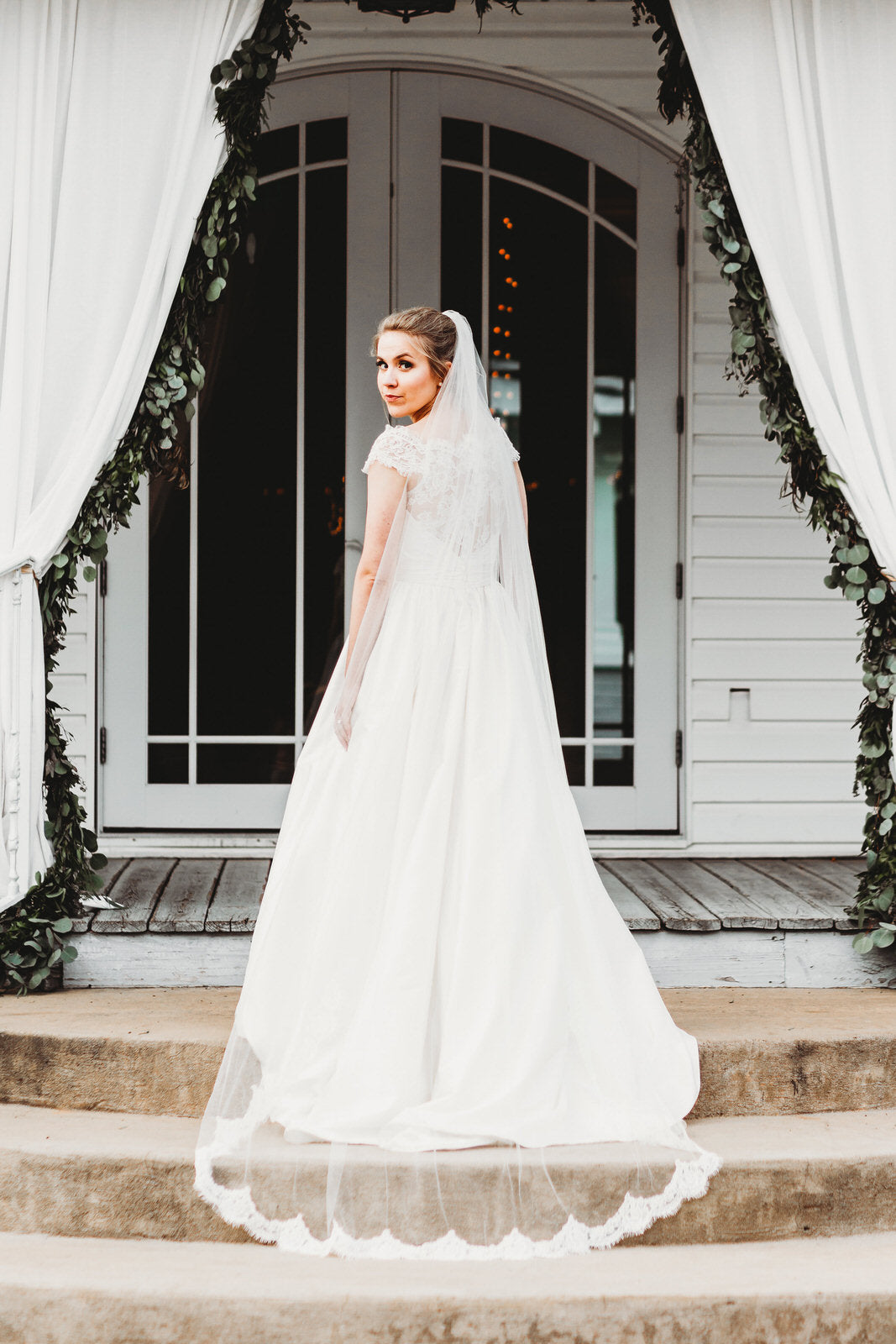 whimsical bride in long chapel length lace veil