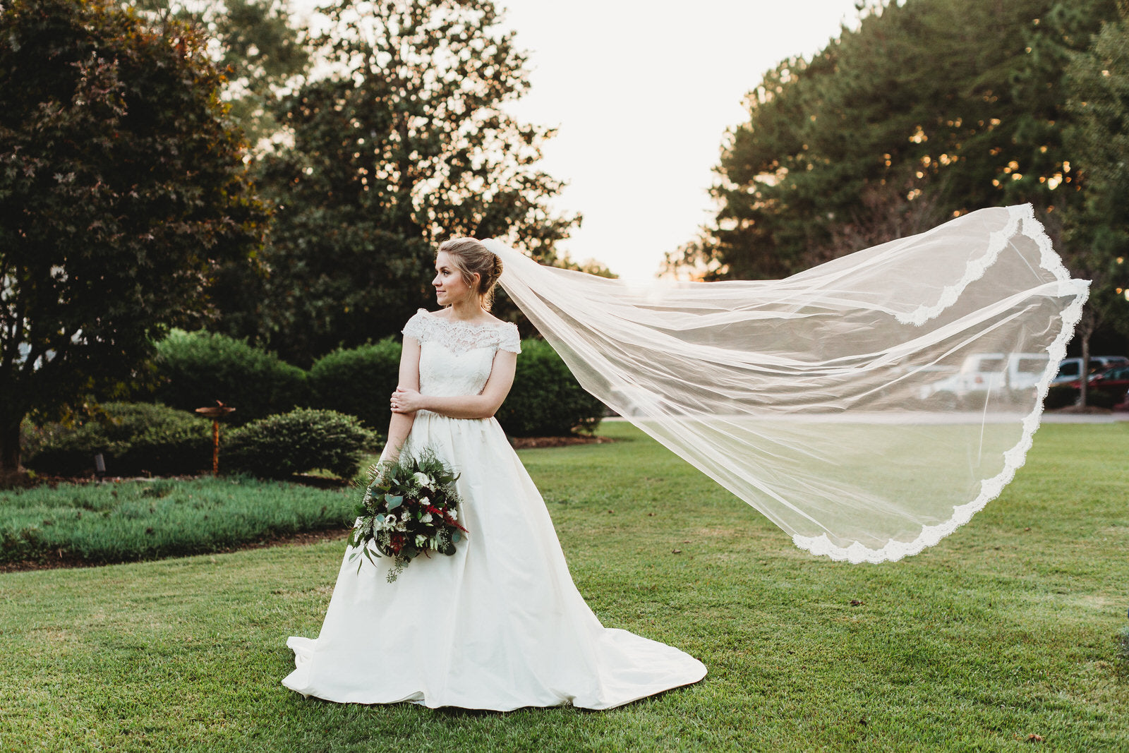 single tier wedding veil with lace blowing in wind