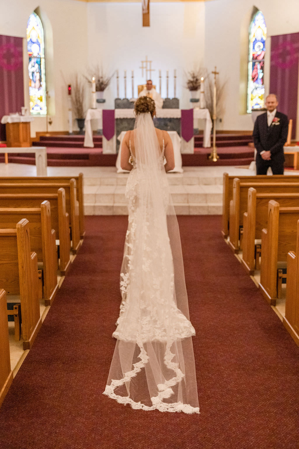 catholic wedding with bride in long floor length wedding veil