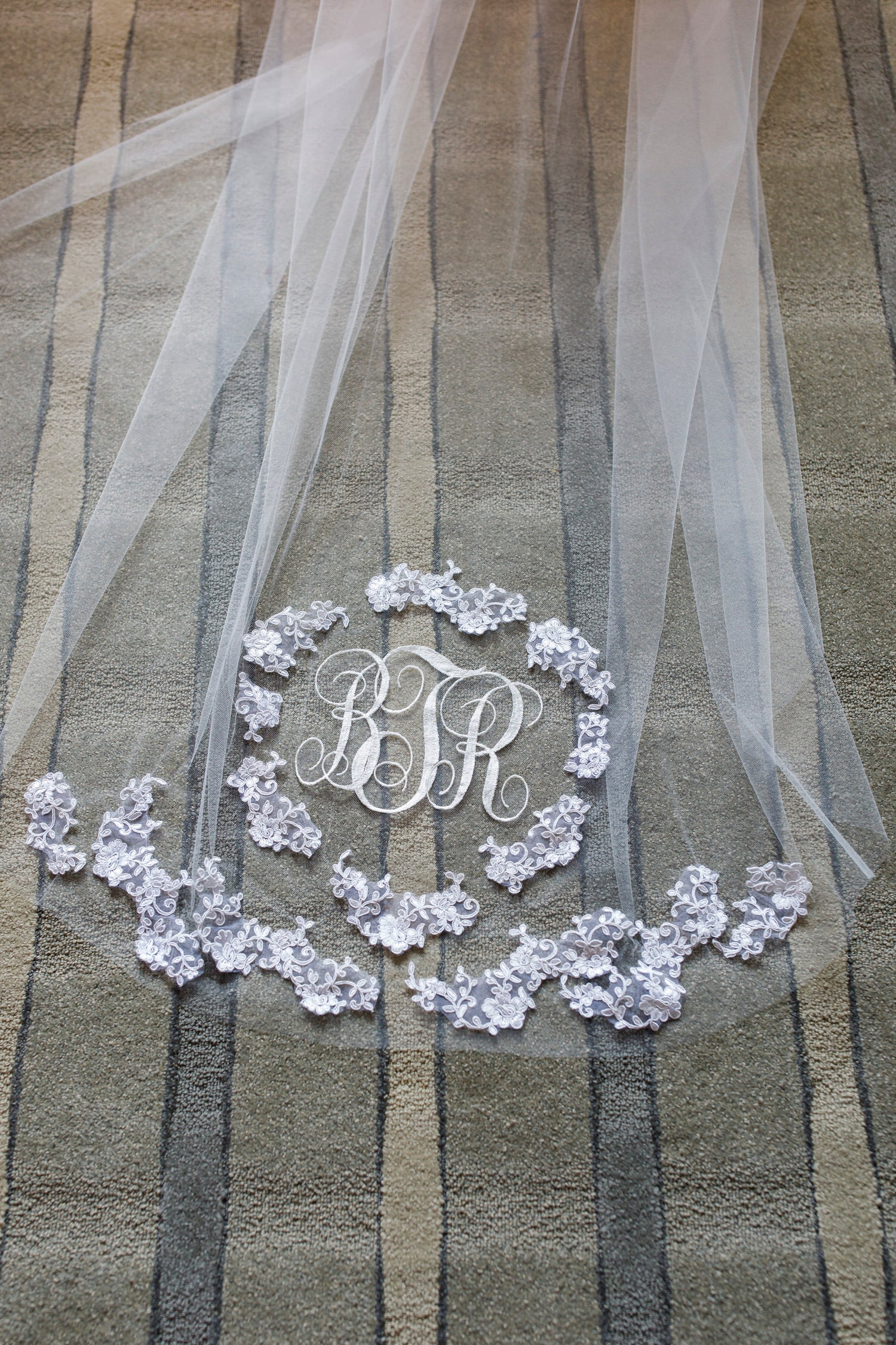 long wedding veil with lace appliques and monograms