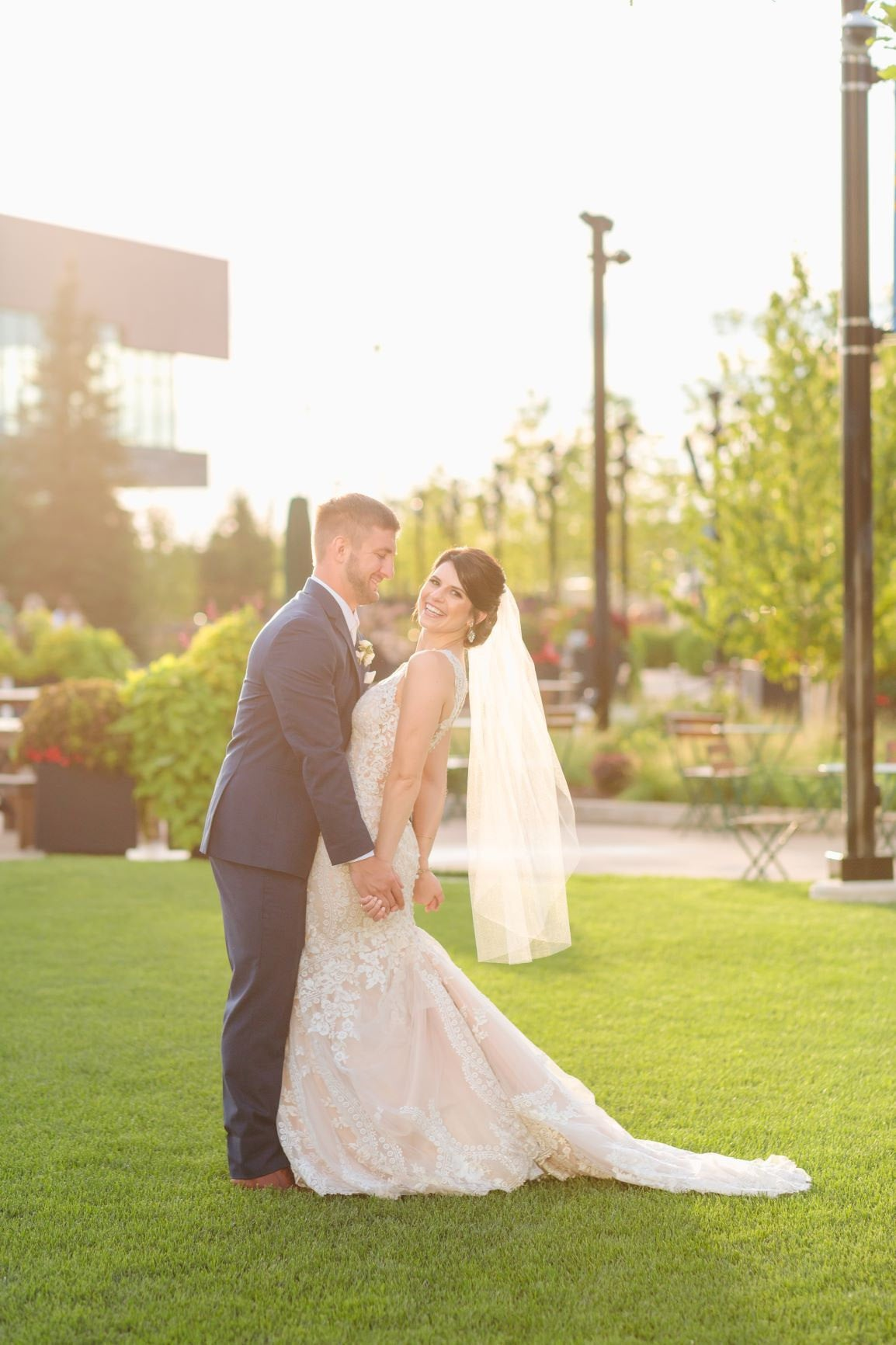 Romantic Wedding Photo of Bride and Groom: Lace Dress and Simple Fingertip Veil by One Blushing Bride