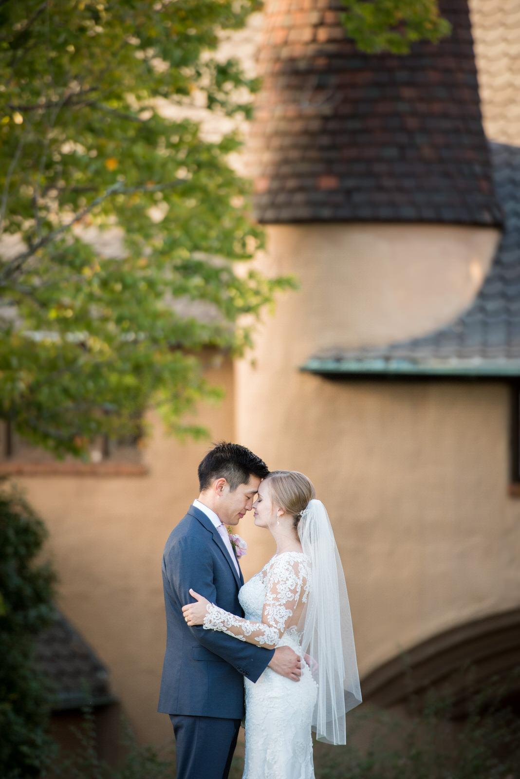 timeless wedding with bride in sheer fingertip length veil over bun