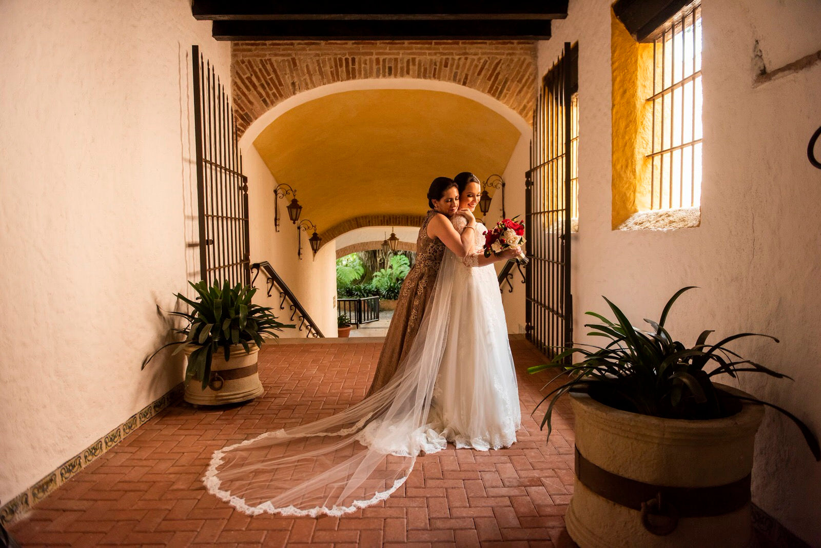 hacienda wedding with bride in long soft wedding veil with lace