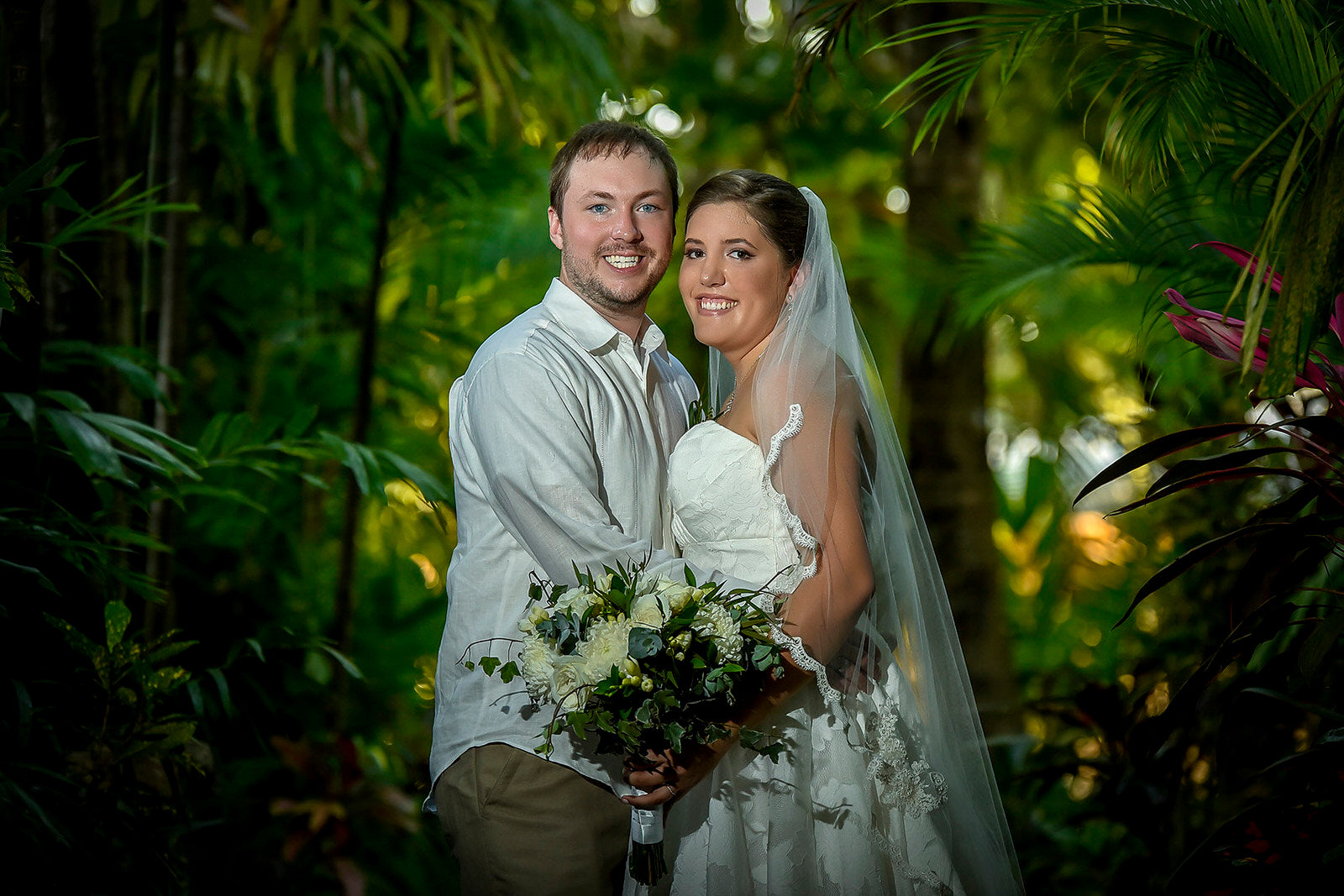 tropical forest wedding with bride in lace scalloped fingertip length bridal veil