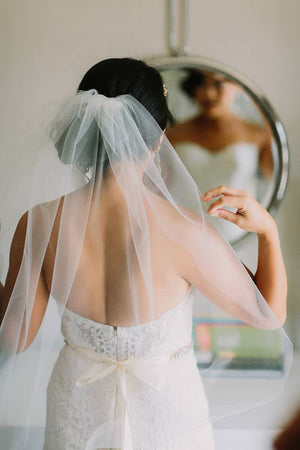strapless wedding dress and sheer one tier short veil