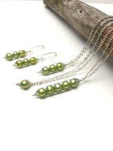 Pea pod pearl earrings with green fresh water pearls