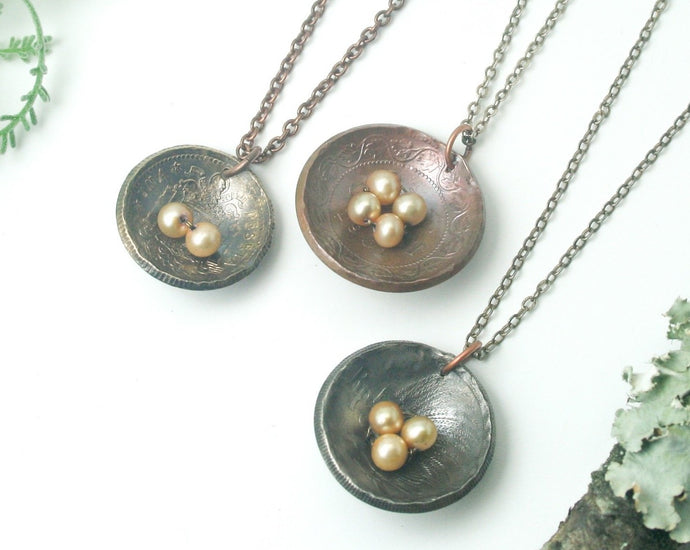 Nest and eggs necklace- cream eggs