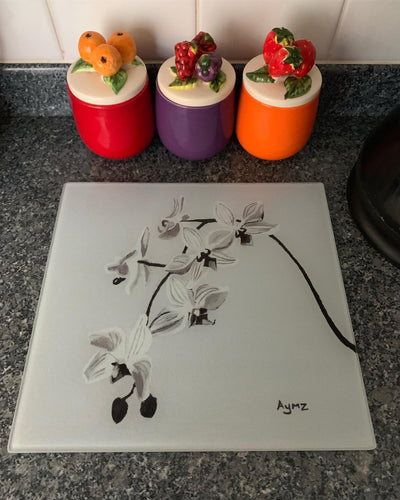 """Wild Orchids in Grayscale"" Glass chopping board"
