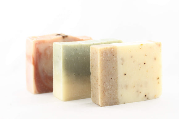 a bar of argan oil and rosehip soap, a bar of peppermint soap and a bar of walnut soap
