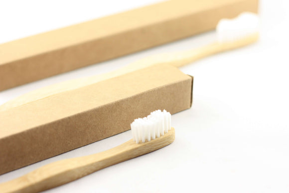one large bamboo toothbrush and one small bamboo toothbrush