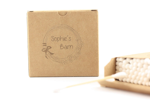 closed brown box of bamboo cotton buds with logo next to an open box of bamboo cotton buds