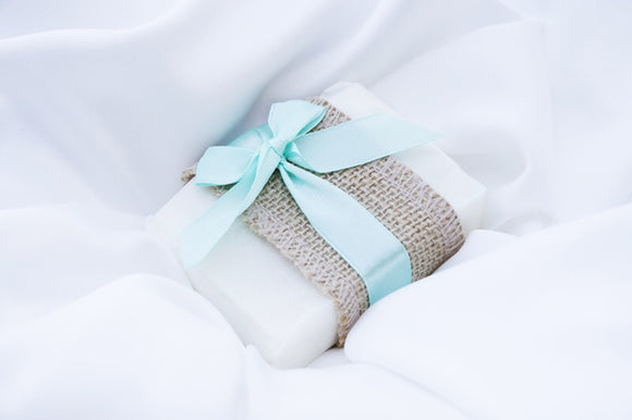 a bar of wedding favour soap wrapped with hessian and a light blue ribbon
