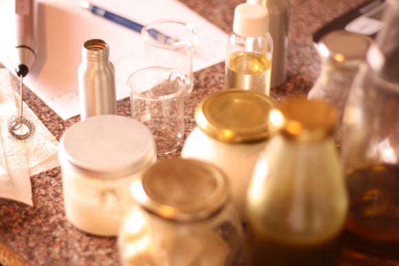 jar and bottles containing oils and lotions