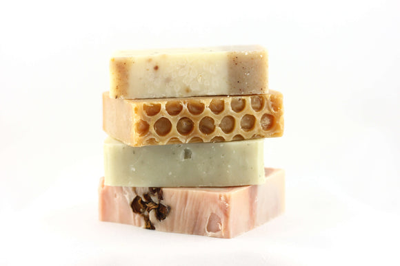 a bar of walnut soap, a bar of honey soap, a bar of peppermint soap and a bar of argan oil and rosehip soap