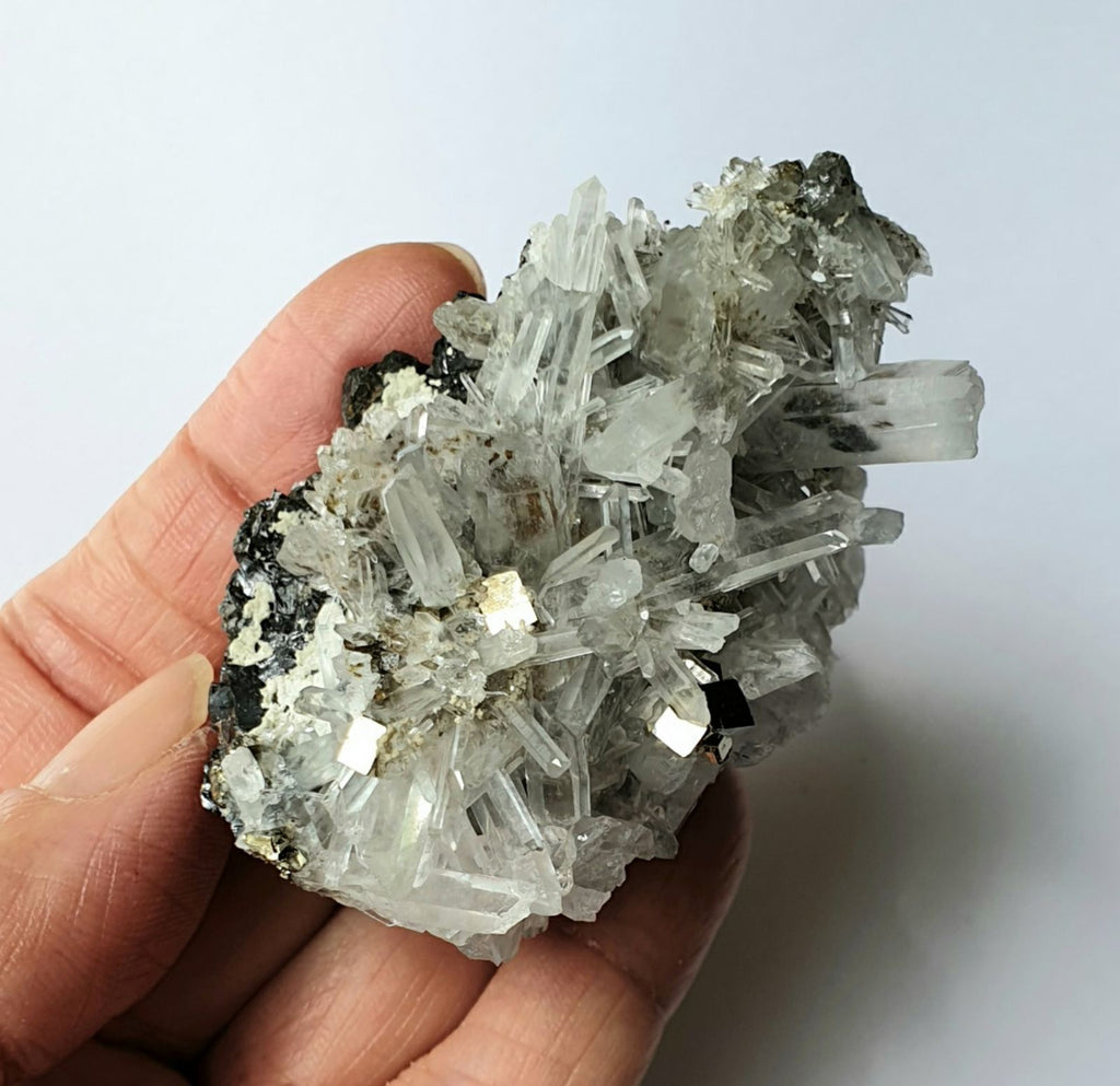 PYR-15: Crystal Quartz Cluster with Pyrite Cubes (Huanzala Mine, Peru)