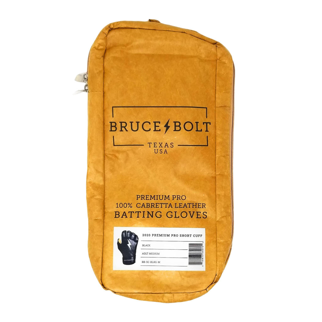 BRUCE BOLT Short Cuff Black 2021 PREMIUM PRO GLOVE BAG. This is a batting glove bag made specifically for carrying BRUCE BOLT batting gloves.  The glove is kraft or tan color with black text and a black lightning bolt.  This bag has BRUCE BOLT Stickers and a Helmet Sticker inside.
