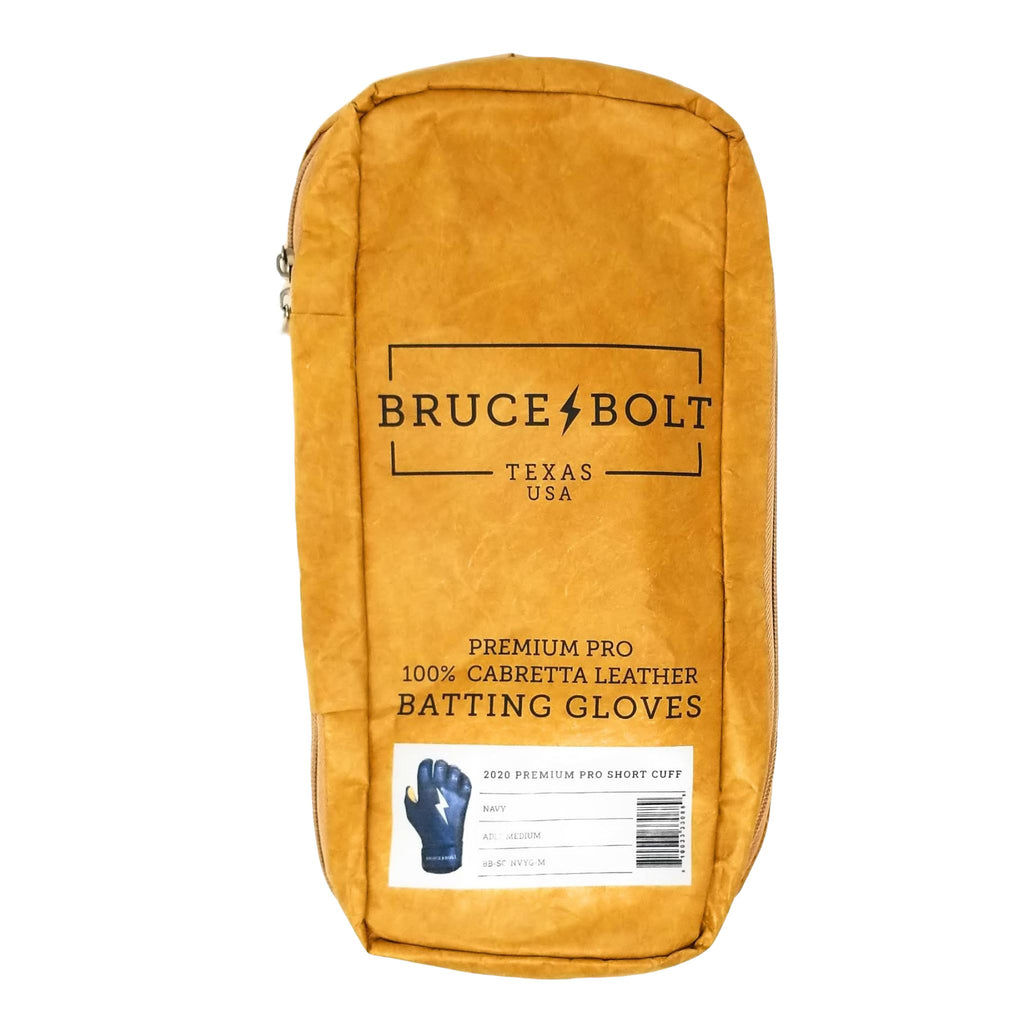 BRUCE BOLT Navy Short Cuff 2021 PREMIUM PRO GLOVE BAG. This is a batting glove bag made specifically for carrying BRUCE BOLT batting gloves.  The glove is kraft or tan color with black text and a black lightning bolt.  This bag has BRUCE BOLT Stickers and a Helmet Sticker inside.