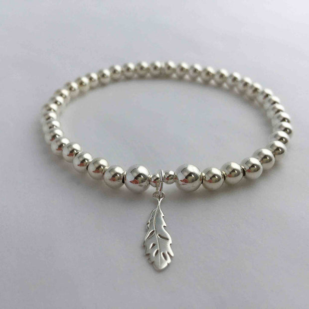 Chica 925 Sterling Silver 5mm Bead Stretch Stacking Bracelet with Feather Charm