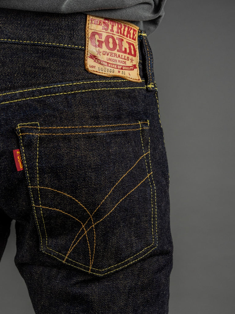 The Strike Gold 2109 Brown Weft Slim Tapered Jeans back pocket