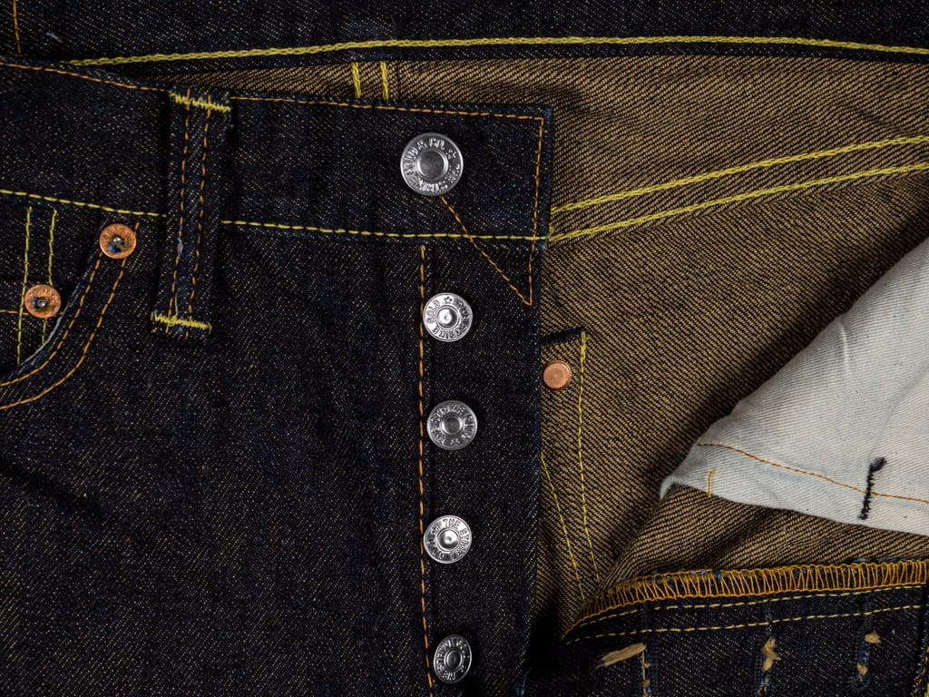The Strike Gold 2109 Brown Weft Slim Tapered Jeans buttons