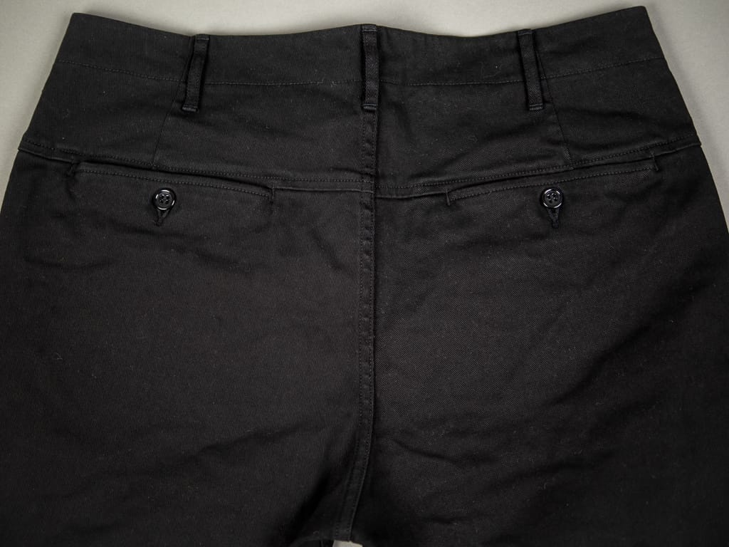 rear buttoned pockets of Spellbound 43-745T Slim Tapered Chinos Black
