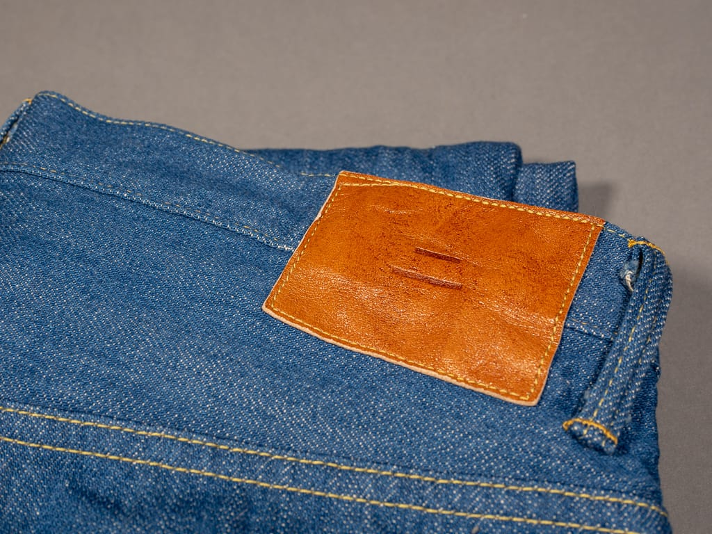 tanuki kt kaze tapered light indigo jeans leather patch